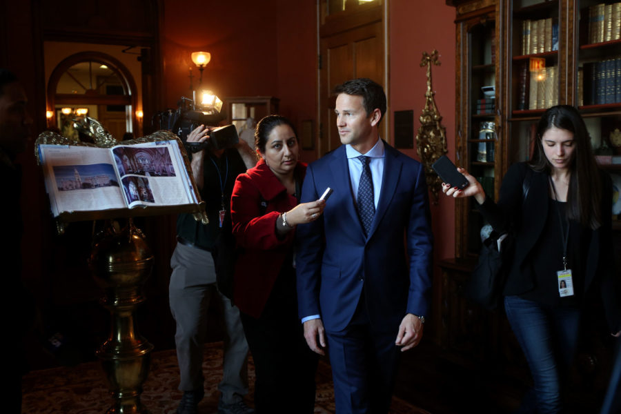 Congressman Aaron Schock speaks to the media as he arrives at an immigration reform panel hosted by the Illinois Business Immigration Coalition Monday, March 9, 2015, at St. Ignatius College Prep in Chicago. Schock resigned Tuesday amid controversy over his spending habits. (Nancy Stone/Chicago Tribune/TNS)