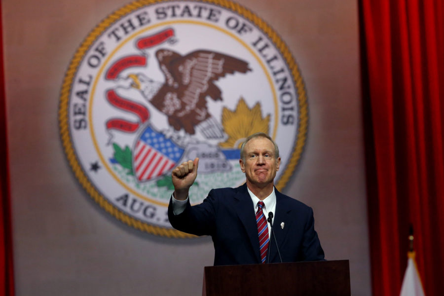 Gov.+Bruce+Rauner+gives+a+thumbs+up+after+giving+his+first+speech+as+governor+on+Jan.+12%2C+2015+at+the+Prairie+Capital+Convention+Center+in+Springfield.+%28Nancy+Stone%2FChicago+Tribune%2FTNS%29