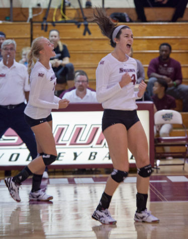 Nellie Fredriksson, left, and McKenzie Dorris celebrate after a point scored during Tuesday's game against SEMO. The Salukis defeated the Redhawks in three sets and improved to 7-3 this season. (DailyEgyptian.com file photo)