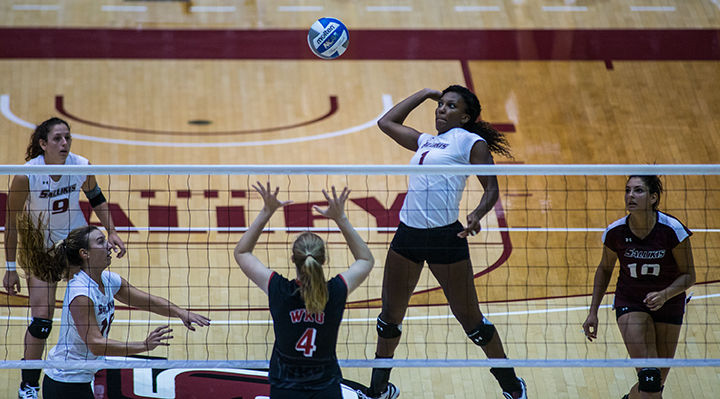 Senior+middle+hitter+Taylor+Pippen+jumps+to+hit+the+ball+Sept.+5+during+the+Salukis%27+3-1+loss+to+Western+Kentucky+during+the+2015+Saluki+Invitational+at+SIU+Arena.%C2%A0%28DailyEgyptian.com+file+photo%29
