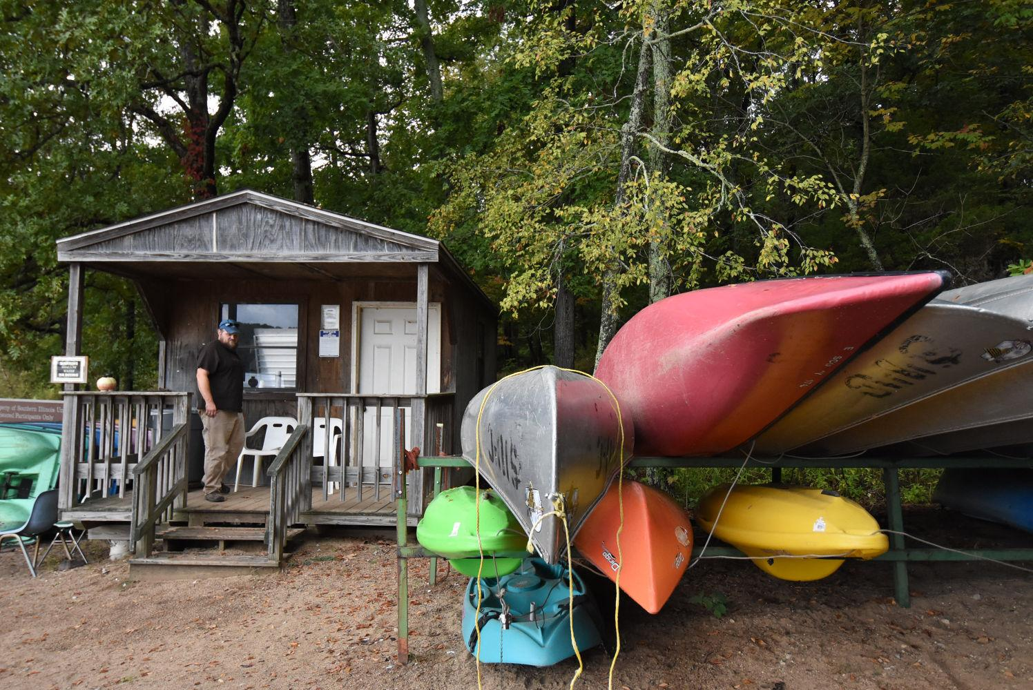 Steve Gariepy, the event organizer for the first two Breaking the Surface paddle events, descends the steps of a shed Tuesday, September 29, 2015, near the beach at Touch of Nature Environmental Center in Makanda. He said he enjoys taking the 34-foot Voyageur canoe on the lake because it has room for many different types of people. He said everyone in the boat has to work together to paddle it.