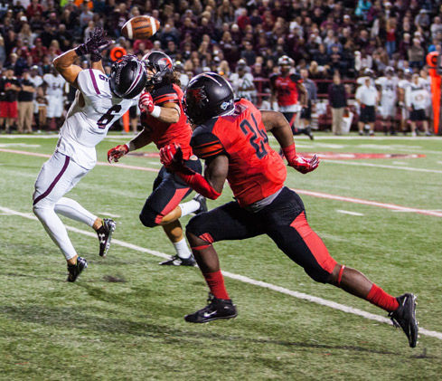Senior safety D.J. Cameron reaches for the ball Sept. 12, 2015, during SIU's 27-24 loss to SEMO.