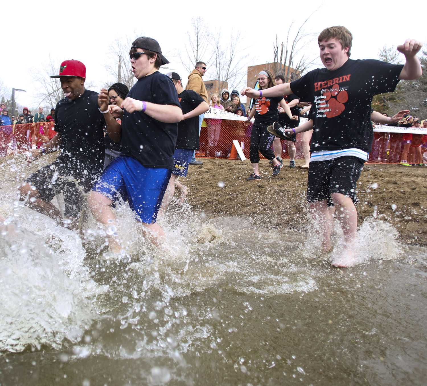 A group of students from Herrin run into Campus Lake on Saturday, Feb. 28, 2015 during the annual Polar Plunge. The event, which benefits the Special Olympics, raised $21,373.94 from 436 participants. (DailyEgyptian.com file photo)