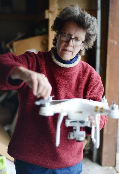 Jan Thompson, an SIU professor of radio, television and digital media, explains the operation of her drone Nov. 16, 2015, at her home. Thompson used the drone in Montana during filming for a documentary. (DailyEgyptian.com file photo)