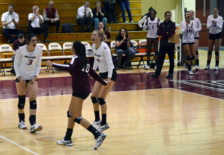 The SIU volleyball team celebrates after scoring a point during a match against Wichita State on Nov. 2 in Davies Gymnasium. The Salukis defeated the Shockers in five sets. (DailyEgyptian.com file photo)
