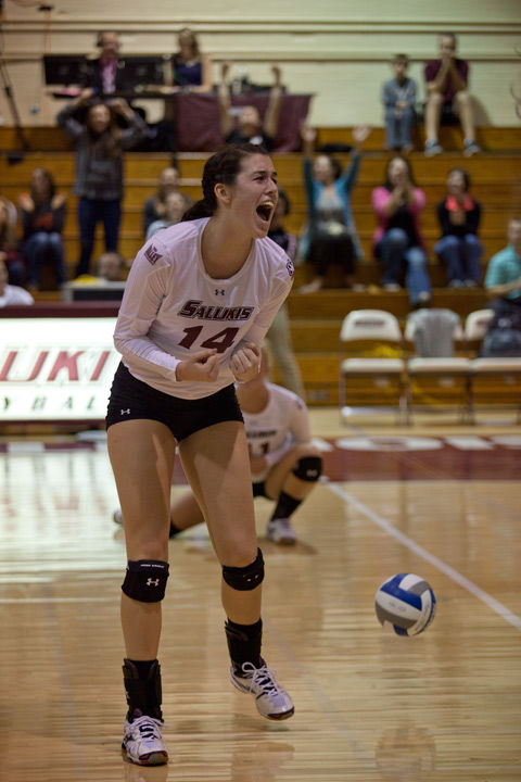 Then junior middle hitter McKenzie Dorris celebrates after a scored point during a match against Missouri State on Oct. 5, 2015, at Davies Gym.