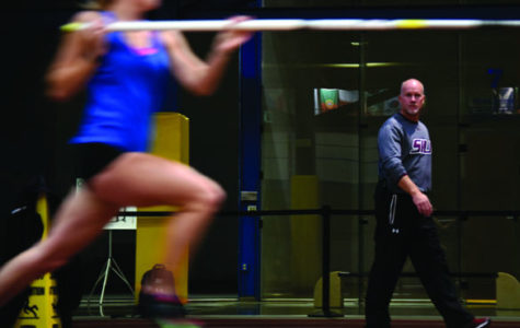 New track and field coach Terry VanLaningham watches junior pole-vaulterKatie Trupp approach a vault during practice Nov. 23, 2015. VanLaningham started at SIU this year coaching jumps, pole vault and multi-event athletes after 11 seasons at Sacramento State University. So far, he has found the transition pleasantly challenging.