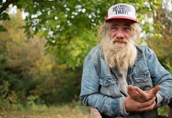 Joe+Sanders+sits+along+a+bike+path+on+the+morning+of+Oct.+25%2C+2015%2C+in+Carbondale.+Sanders+became+homeless+about+15+years+ago+after+he+lost+his+trailer.+Sanders+said+he+typically+goes+to+a+shelter+south+of+Carbondale+when+it+gets+colder%2C+but+plans+to+stay+in+town+this+year+because+of+the+predicted+weather+pattern.+%22It+could+get+down+to+zero%2C%22+Sanders+said.+Sanders+said+he+has+things+lined+up+to+get+a+sleeping+bag+to+stay+warm.+%28Jacob+Wiegand+%7C+%40jawiegandphoto%29