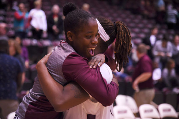 Point+guard+Rishonda+Napier+hugs+then-senior+forward%2Fcenter+Dyana+Pierre+after+SIU%E2%80%99s+102-69+victory+against+Morehead+State+on+Dec.+12+at+SIU+Arena.+%28DailyEgyptian.com+file+photo%29