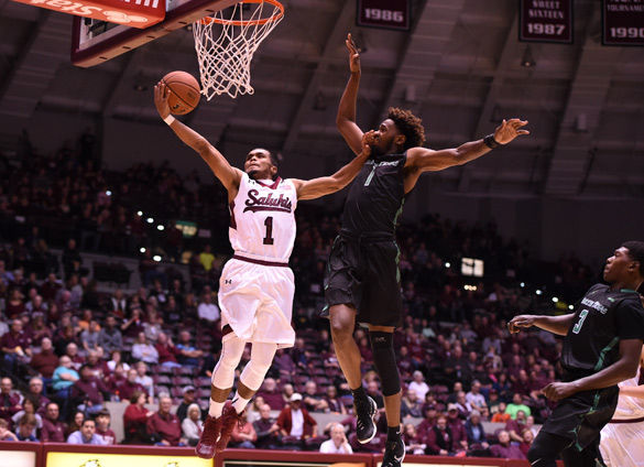 Saluki guard Mike Rodriguez attempts a basket during SIU's 74-66 victory against North Texas on Dec. 12 at SIU Arena. (DailyEgyptian.com file photo)