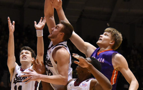 Left to right: Junior guard Tyler Smithpeters, junior forward Sean O'Brien, junior center Bola Olaniyan and Evansville senior center Egidijus Mockevicius scramble for the ball during SIU's 85-78 overtime loss the Evansville on Jan. 28 at SIU Arena.