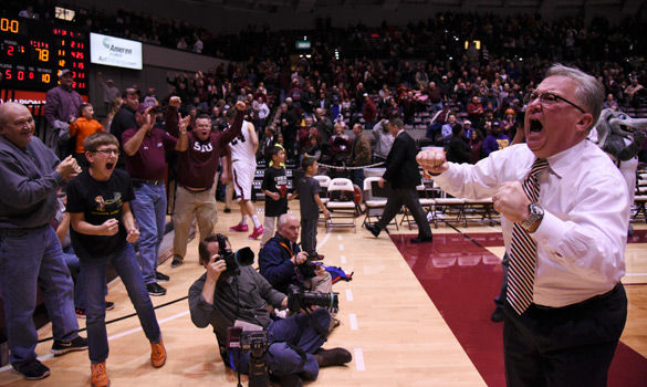 Saluki coach Barry Hinson celebrates with fans after SIU's 81-78 win against Illinois State on Jan. 12 at SIU Arena. (Jacob Wiegand | @JacobWiegand_DE)