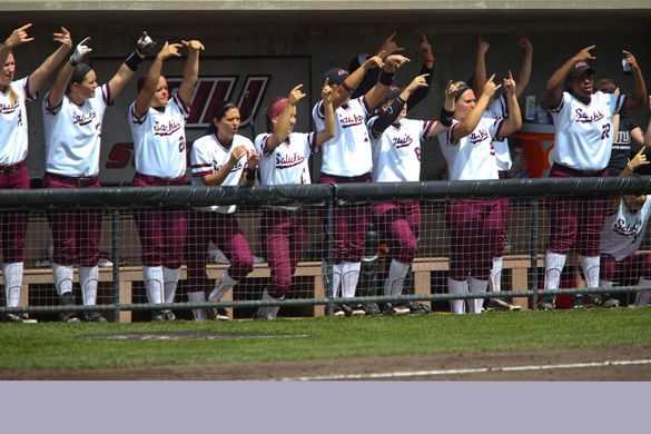 Members of the softball team celebrate on Apr. 12 after  freshmen Sydney Jones hit a double during SIU's 3-2 loss to Drake University. The team currently has a five game losing streak.