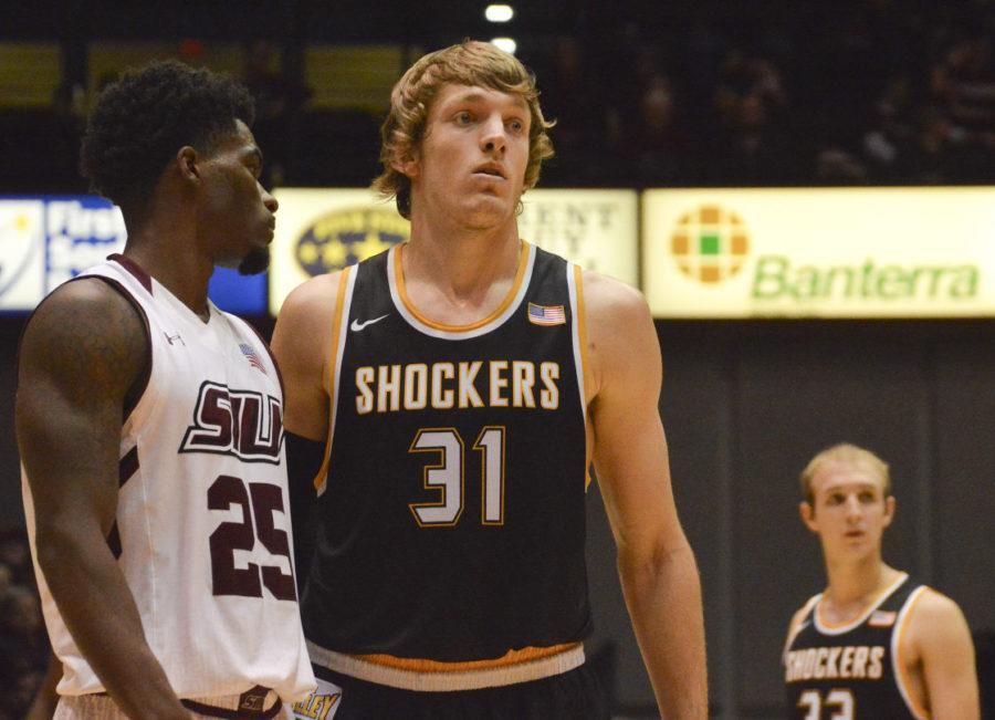 Two Missouri Valley Conference Player of the Year candidates, Anthony Beane, left, and Ron Baker stand on the court Saturday during SIU's loss to Wichita State. (Luke Nozicka | @LukeNozicka)