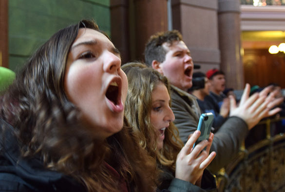 "SIU students (right to left) Tyler Yates, a freshman in zoology; Grace Vargas, a freshman in anthropology and Andrea Storey, a freshman in Spanish, were among the students chanting ""save our schools"" Feb. 17 at the State Capitol during Gov. Bruce Rauner's budget address."