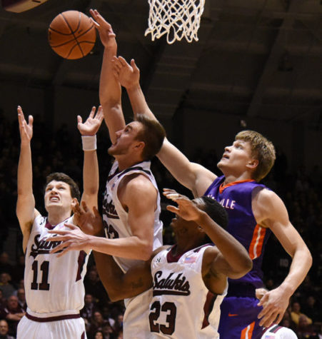 Left to right: Saluki guard Tyler Smithpeters, forward Sean O'Brien, center Bola Olaniyan and Evansville center Egidijus Mockevicius scramble for the ball during SIU's 85-78 overtime loss the Evansville on Jan. 28 at SIU Arena. (Jacob Wiegand | @JacobWiegand_DE)
