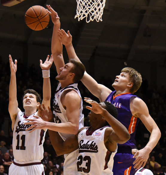 Left to right: Saluki guard Tyler Smithpeters, forward Sean O'Brien, center Bola Olaniyan and Evansville center Egidijus Mockevicius scramble for the ball during SIU's 85-78 overtime loss the Evansville on Jan. 28 at SIU Arena.(Jacob Wiegand | @JacobWiegand_DE)