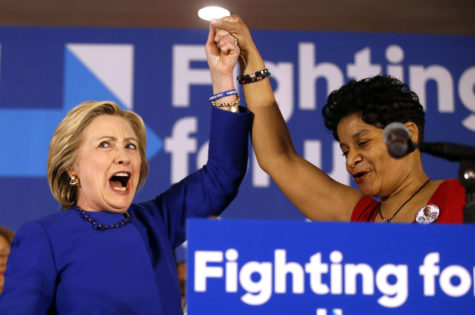 A spirited Democratic presidential candidate Hillary Clinton, left, joins Geneva Reed-Veal, the mother of Sandra Bland, during a campaign rally at the Parkway Ballroom on Chicago's South Side on Wednesday.