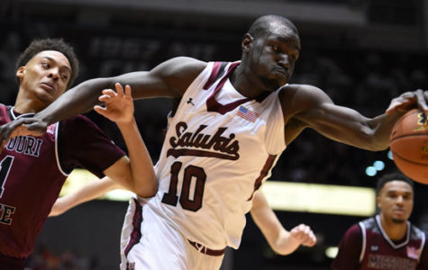 Senior center Ibby Djimde attempts to grab the ball during SIU's 78-68 victory against Missouri State on Feb. 27 at SIU Arena. Djimde scored two points and had one rebound in the game.