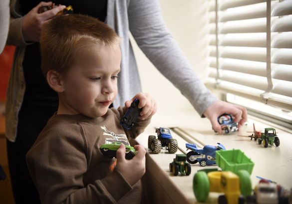 "Dominick lines up toy cars along a windowsill under the supervision of Mary Foreman, a graduate student in communications disorders and science from Edwardsville, during a therapy session Tuesday at SIU's Center for Autism Spectrum Disorders in Wham Education Building. The center will close after this semester if no state budget is passed. Valerie Boyer, director of SIU's Center for Autism Spectrum Disorders, said the uncertainty is the most difficult part. ""We've been waiting a long time,"" said Boyer, an associate professor in communication disorders and sciences. ""We feel like we perform a valuable community service so we would like to see it resolved, but honestly, just the knowing would be nice."" The center has been referring patients to Missouri, as the only facilities remaining in southern Illinois are private practices. ""For a lot of people this isn't an option because they can't afford the out-of-pocket expenses,"" Boyer said."