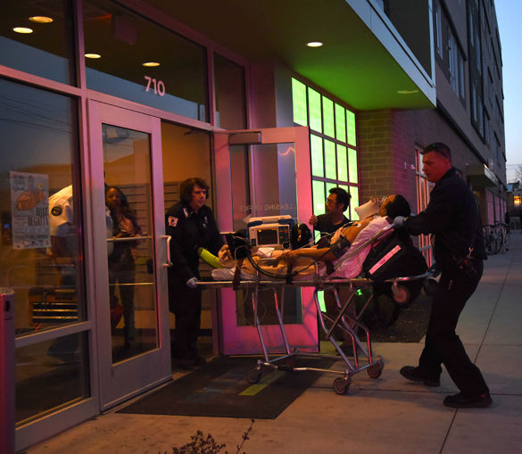 A male is wheeled out of Evolve Apartments at SIU on a stretcher March 29 in Carbondale. — March 29, 2016. Carbondale, Ill.