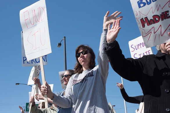 Young and old rally against state budget crisis