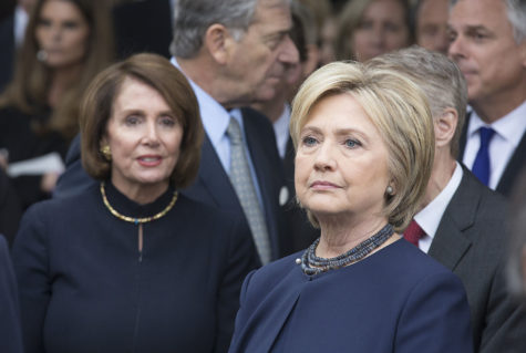 Hillary Clinton, right, and Nancy Pelosi, left, wait to pay respects with Reagan family members at Nancy Reagan's gravesite at the Ronald Reagan Presidential Library in Simi Valley, Calif., on March 11. (Chicago Tribune)