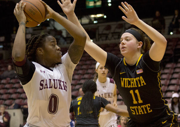 Saluki forward/center Dyana Pierre attempts a basket during SIU'S 80-66 win against Wichita State on March 11 at SIU Arena. (DailyEgyptian.com file photo)