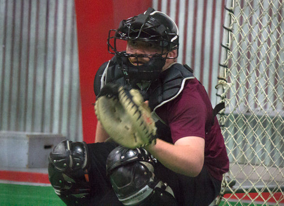 Bullpen catcher Ethan Maxey moves to catch a baseball during practice March 9 atGarden Grove Event Center. — March 9, 2016, Carbondale, Ill.