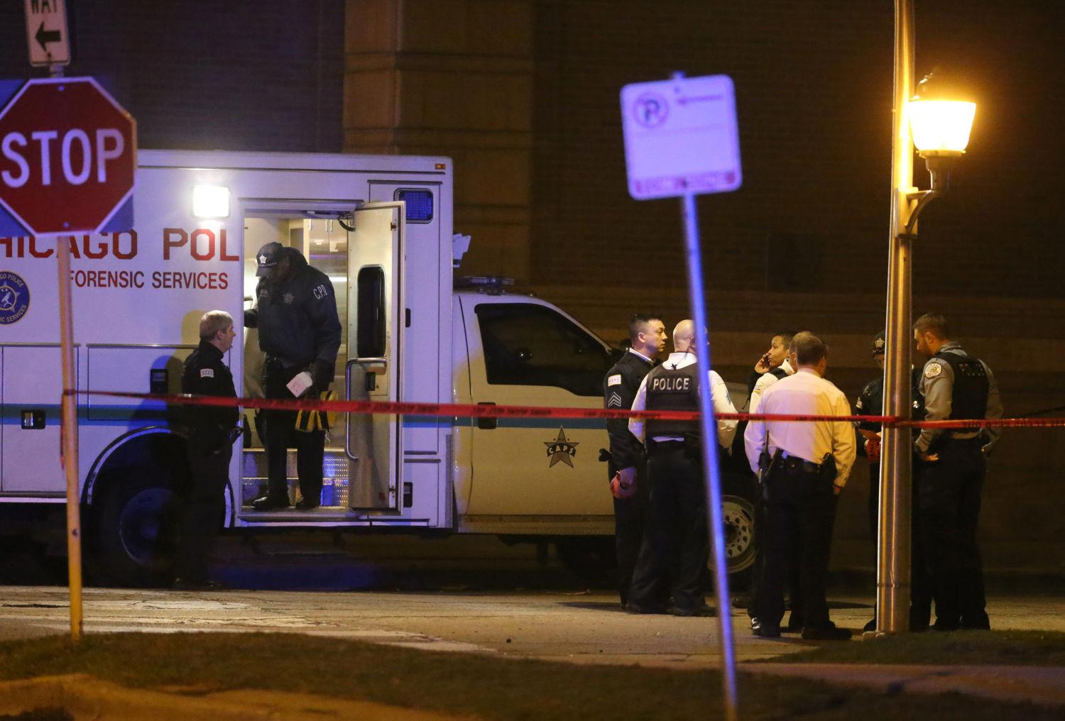 Chicago police officers work on the scene where three officers were shot in the 3700 block of West Polk Street on March 14 in the Homan Square neighborhood of Chicago.