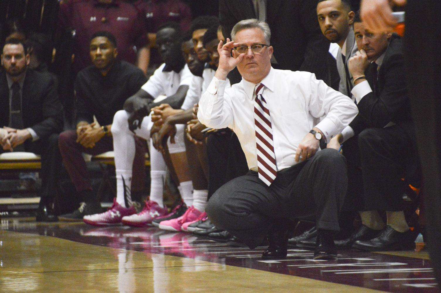 SIU men's basketball coach Barry Hinson squats during SIU's 83-58 loss to the Shockers on Jan. 9 at SIU Arena. (DailyEgyptian.com file photo)