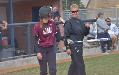 Saluki softball outdoes the elements, Racers in offensive outburst