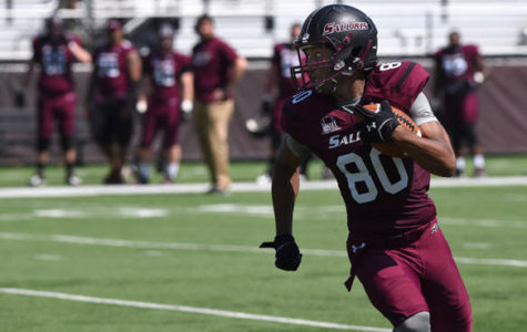 Then-junior tight end John Gardner runs with the ball during Saluki football's annual Spring Game on April 23 at Saluki Stadium. (DailyEgyptian.com file photo)