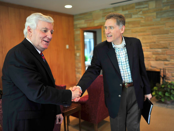 Glenn Poshard shakes the hand of his successor, SIU President Randy Dunn on April 30 when the two met to discuss key university issues at the Stone Center. Dunn toured both the Edwardsville and Carbondale campuses the next day. (DailyEgyptian.com file photo)
