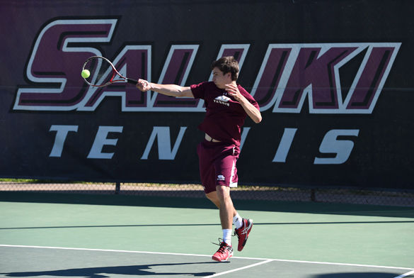 Junior Piotr Baranski hits the ball during Saluki tennis' 4-3 win against Illinois State on Saturday, April 9, 2016, at University Courts in Carbondale. Baranski won his singles and doubles contests during the match. (Daily Egyptian file photo)