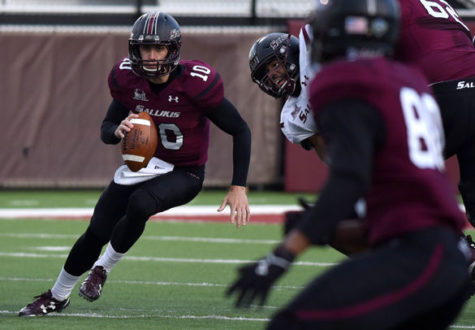 Redshirt freshman quarterback Tanner Hearn, of Florida, runs with the ball April 8 during' second scrimmage game of the season at Saluki Stadium. (DailyEgyptian.com file photo)