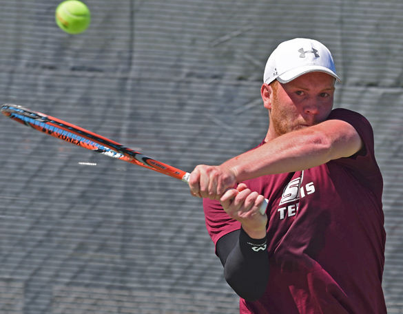 Senior+Jonny+Rigby+sends+the+ball+back+to+the+opposite+end+of+the+court+during+Saluki+tennis%E2%80%99+4-3+win+against+Illinois+State+on+April+9+at+University+Courts.+Rigby%2C+the+lone+senior+on+the+team%2C+was+recognized+prior+to+the+match+during+the+team%E2%80%99s+senior+day+ceremony.+Rigby%E2%80%99s+parents%2C+Karen+and+David+Rigby%2C+traveled+from+England+to+see+their+son+perform+in+his+final+home+match.+%E2%80%9C%5BTennis%5D+shaped+his+whole+life%2C%E2%80%9D+David+said.+%E2%80%9CHe%E2%80%99s+always+wanted+to+play.%E2%80%9D+Rigby%E2%80%99s+parents+said+he+has+been+playing+tennis+since+he+was+4+years+old.+Rigby+won+his+singles+and+doubles+matches+on+the+day.+%E2%80%94+April+9%2C+2016%2C+Carbondale%2C+Ill.+%28Jacob+Wiegand+%7C+%40jawiegandphoto%29