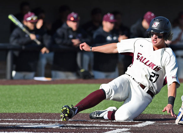Then-sophomore infielder Greg Lambert slides into home during the Salukis' 7-6 win against Indiana State on Friday, April 8, 2016 at Itchy Jones Stadium. Lambert had one hit and two runs during the game.