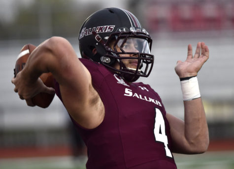 Sophomore quarterback Sam Straub practices his throw April 1 during Saluki Football's first-ever scrimmage at DuQuoin High School. (DailyEgyptian.com file photo)