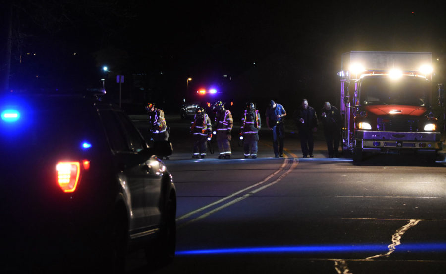 Carbondale police and firefighters use flashlights and lights from a firetruck to search the 900 block of East College Street on Saturday night. — April 9, 2016 in Carbondale, Ill.(Luke Nozicka | @lukenozicka)