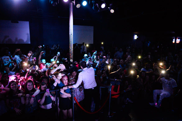 Concertgoers react to rapper Lil Wayne on stage early Tuesday morning in Levels nightclub in Carbondale.
