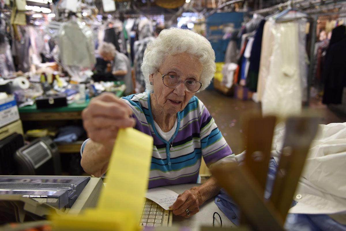 "Betty Louise Kiefer, of De Soto, grabs a tag for a customer's order April 21 at Horstman's Cleaners & Furriers in Carbondale. Kiefer is 87 years old and has worked at the local dry cleaners since she was 18. When she started she wanted to help her husband with building their home in De Soto. ""We'd order a load of lumber and we'd get that paid for and we'd order another load of lumber until we got our house built,"" she said. Kiefer still lives in the same house her husband built. She said she likes working so she continued doing it. ""I just like it and people seem to like me,"" Kiefer said. ""They expect me to be out there if they come. I'm the fixture at Horstman's Cleaners."" — April 21, 2016, Carbondale, Ill. (Jacob Wiegand 