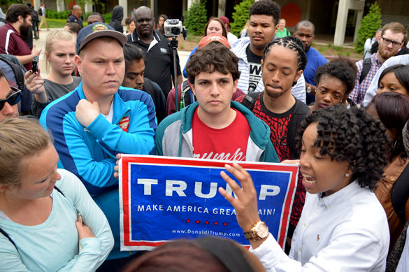 Supporters of Republican presidential candidate Donald Trump converse with SIU freshman MiKala Barrett on Monday outside Faner Hall following the May 2 protest. One of the issues addressed in the protest was racism at SIU, much of which has concerned the controversial presidential candidate. — May 2, 2016, Carbondale, Ill.