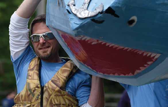 Brandon+Parker+carries+his+team%27s+boat%2C+%22Sharky%2C%22+to+the+starting+line+April+30+at+the+43rd+Annual+Great+Cardboard+Boat+Regatta+at+the+Carbondale+Reservoir+at+Evergreen+Park.+Parker+entered+the+race+with+fellow+Lowe%27s+Home+Improvement+employees+and+the+group+finished+second+in+the+Class+I+category.+%E2%80%94+April+30%2C+2016%2C+Carbondale%2C+Ill.+%28Morgan+Timms+%7C+%40morgan_timms%29