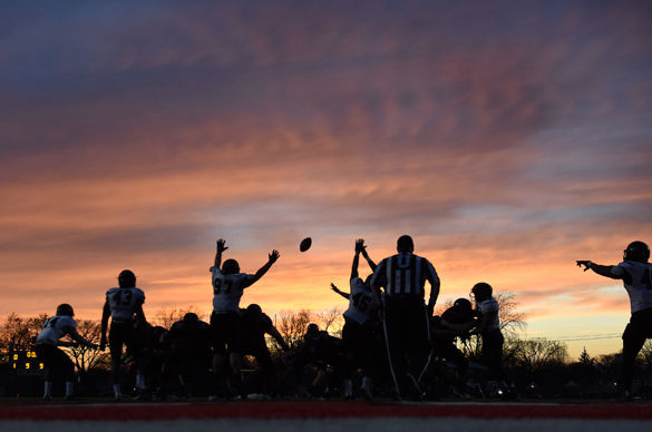 Members of the SIU football team attempt to block a field goal during Saluki football's Du Quoin scrimmage game Friday, April 1, 2016, at DuQuoin High School. (Jacob Wiegand | @jawiegandphoto)