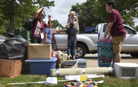Jacqueline Morales, in truck, a junior studying animation, is assisted by Saluki Startup volunteers as she moves into her dorm on Thursday, Aug. 18, 2016, outside Kellogg Hall. This is Jacqueline's third year living in the residence halls. She said she likes the dorms because it is easier to commute to class.