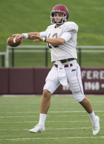 Quarterback Josh Straughan looks to make a pass during SIU's fall football scrimmage on Saturday, Aug. 20, 2016, at Saluki Stadium in Carbondale. (Ryan Michalesko | @photosbylesko)