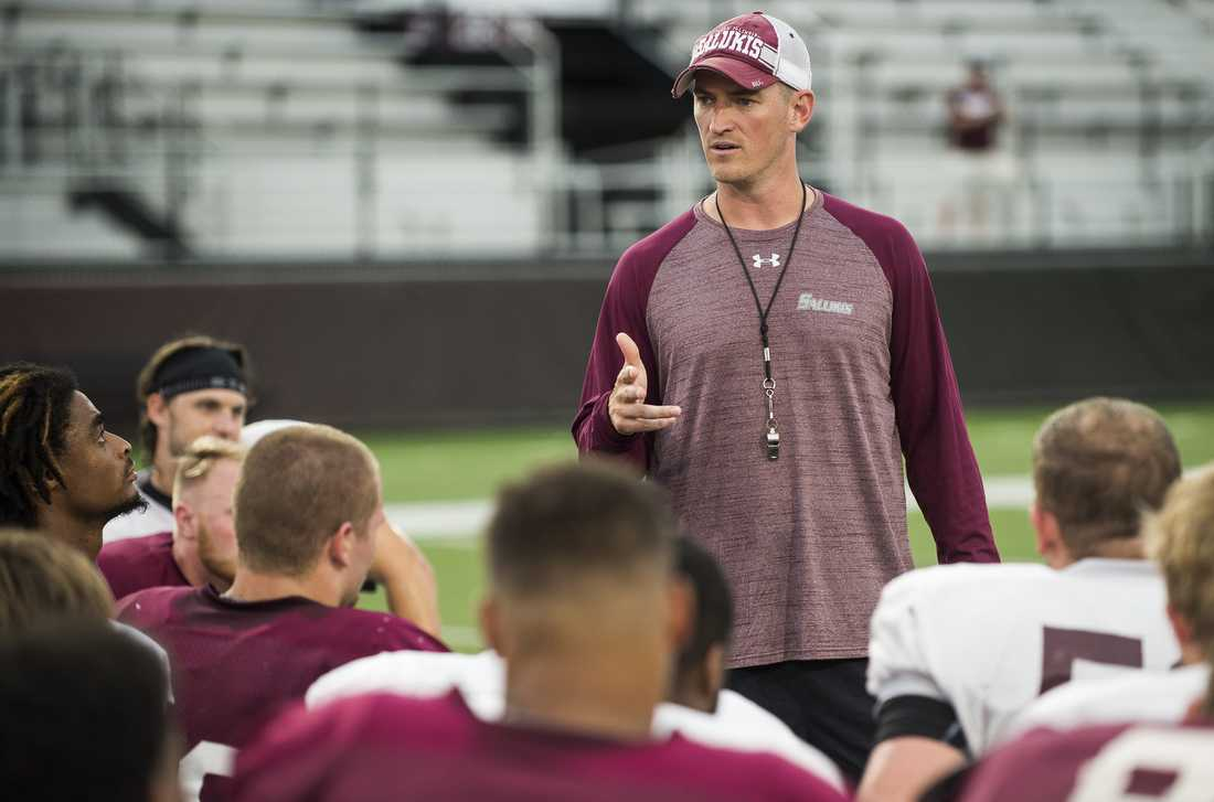 Head football coach Nick Hill speaks with the team following SIU's fall football scrimmage Saturday, Aug. 20, 2016, at Saluki Stadium in Carbondale. (Ryan Michalesko | @photosbylesko)