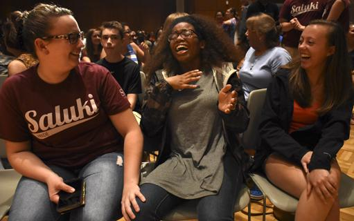 From left: Heather Duzan, a sophomore from Robinson studying psychology, shares a moment with Eliana Tiggens, a sophomore from Chicago studying cinematography and animation, Friday, Aug. 26, 2016, during Chris Jones' performance at the Student Center. (Athena Chrysanthou | @Chrysant1Athena)