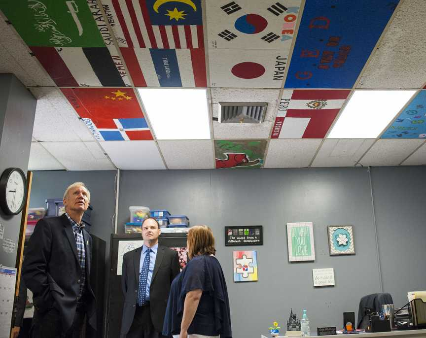 Gov. Bruce Rauner looks at student-painted ceiling tiles during his visit Friday, Aug. 26, 2016, to Carbondale High School's Rebound program in Carbondale. (Ryan Michalesko | @photosbylesko)